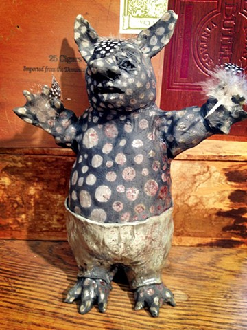 raku ceramic spotted monster in pea green pants
