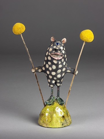 little raku ceramic monster with pom poms