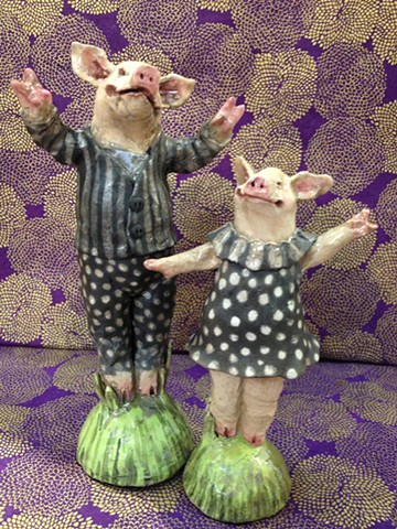 small raku pigs by lisa schumaier