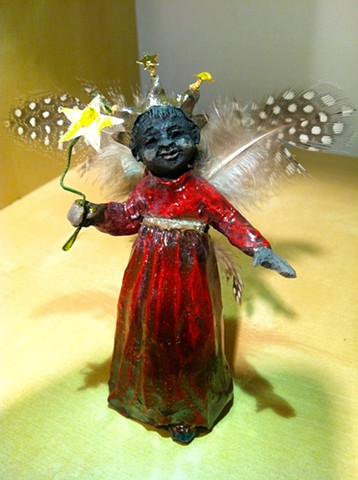 Little raku ceramic African-American angel by lisa schumaier