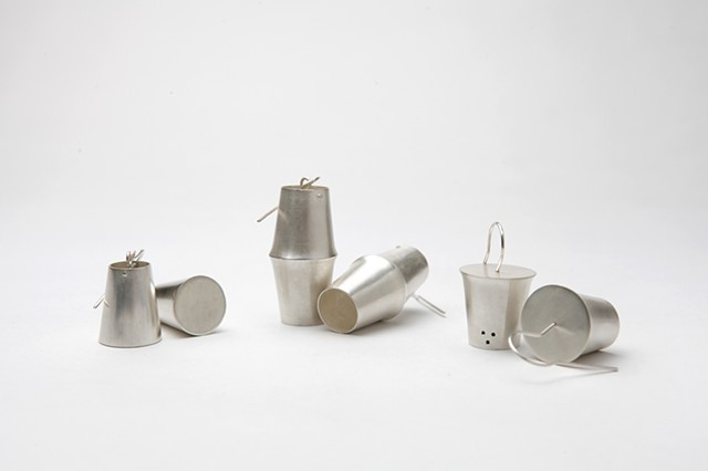 Sterling silver earrings by Sara Owens; left to right: Tumbler Earrings, Chimney Earrings, Temple Earrings