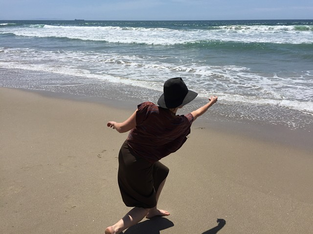 Me skipping my future ashes into the ocean. They have been pressed into rock forms and kiln dried.