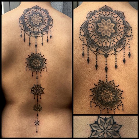 this is an ornate mandala spine tattoo done by amanda marie tattooer at evermore tattoo in culver city los angeles california