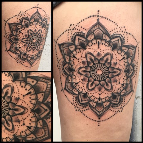 this is a black and grey mandala done by amanda marie lady tattooer in los angeles california at evermore tattoo