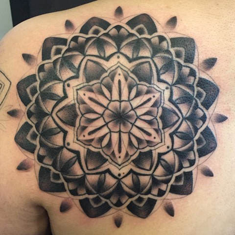 this is a black and grey mandala tattooed by female tattooer amanda marie at evermore tattoo company in los angeles california