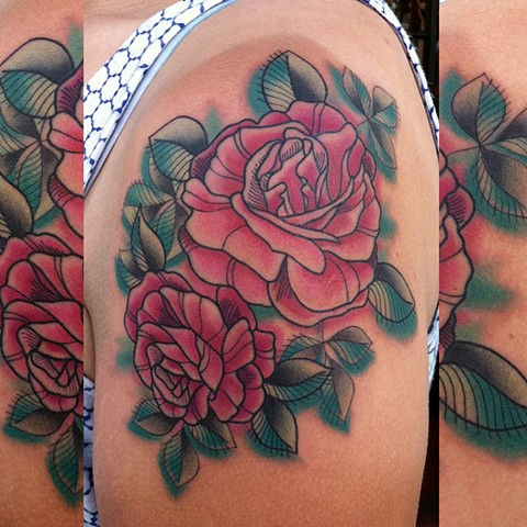 this is a tattoo of roses done in a watercolor style by amanda marie at evermore tattoo in culver city los angeles california