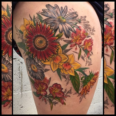 this is a floral tattoo done in a realistic style by amanda marie at evermore tattoo in los angeles california