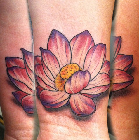 This is a tattoo of a pink lotus flower done by amanda marie at evermore tattoo in los angeles california