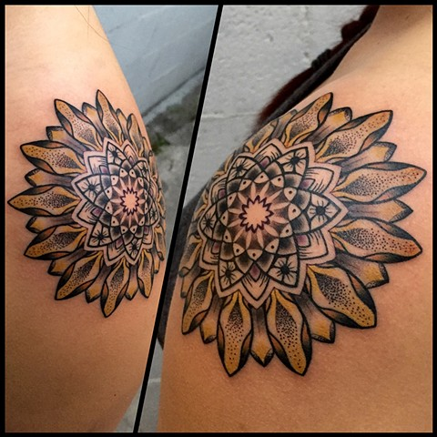 this is a tattoo of a sunflower mandala by amanda marie tattooer she will be at the boston tattoo convention at tattooing in salem Massachusetts