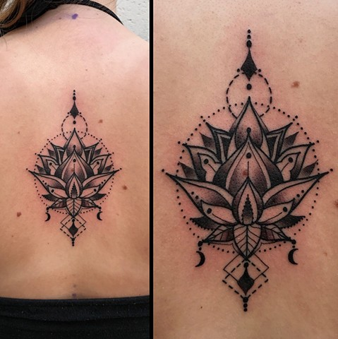 this is a geometric lotus tattoo done by Amanda Marie tattooer owner of ace of wands private tattoo studio in San Pedro California Los Angeles county