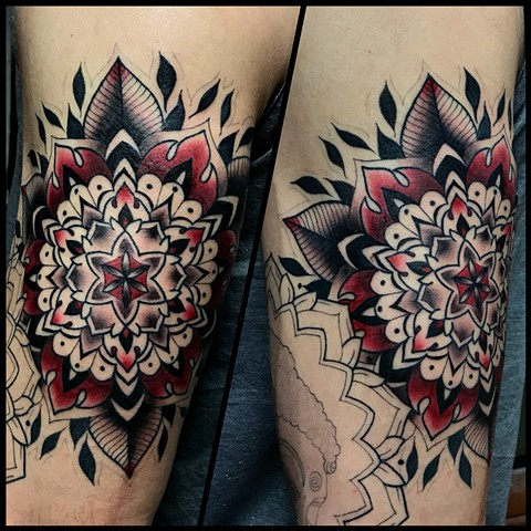 this is a red mandala tattoo that is geometric and inspired by sacred geometry done by amanda marie tattooer at ace of wands intimate private tattoo studio in los angeles california san pedro palos verdes