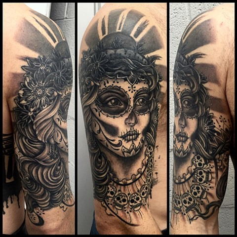 This is a tattoo of a day of the dead dia de los muertos lady head done in black and grey by amanda marie tattooer in los angeles california at evermore tattoo