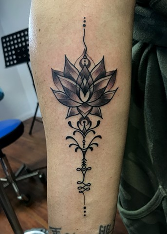 this is a unalome tattoo that includes a lotus on the path to enlightenment done in black and grey by Amanda Marie tattoo artist and owner of ace of wands tattoo in San Pedro California Los Angeles sacred space for art and tattooing