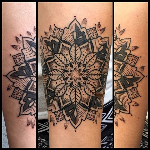 this is a black work mandala tattoo done by amanda marie tattooer in los angeles california