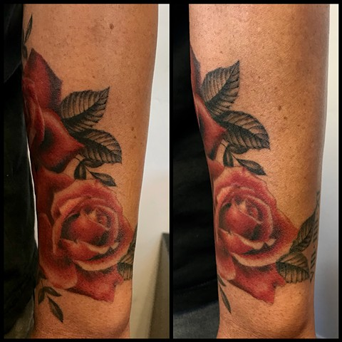 this is a tattoo of a realistic red rose done by amanda marie tattooer at ace of wands intimate private tattoo studio in san pedro los angeles california