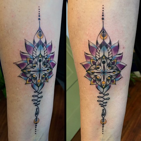 this is a lotus unalome tattoo done in color by Amanda Marie tattooer it includes moon symbolism and was done in Los Angeles San Pedro California at private tattoo studio and sacred space ace of wands tattoo