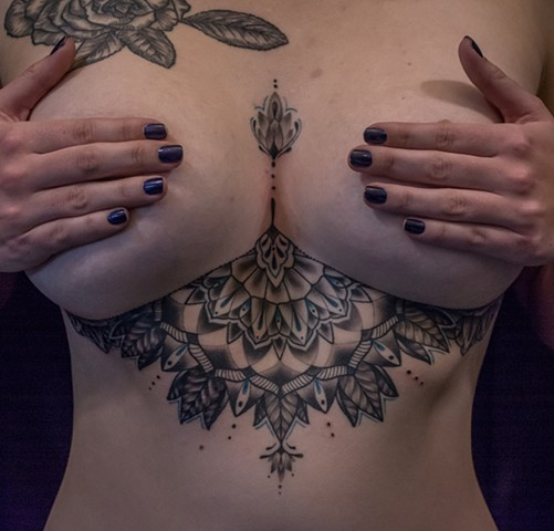 this is a geometric mandala underboob tattoo done by amanda marie lady tattooer who will be tattooing at the boston tattoo convention and in salem massachusetts
