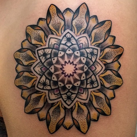 this is a sunflower mandala tattooed by amanda marie lady tattooer she will be tattooing at the boston tattoo convention and in salem massachusetts