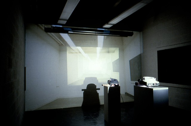 slide projector installation using 6 slide projectors projecting image of room inside of itself.