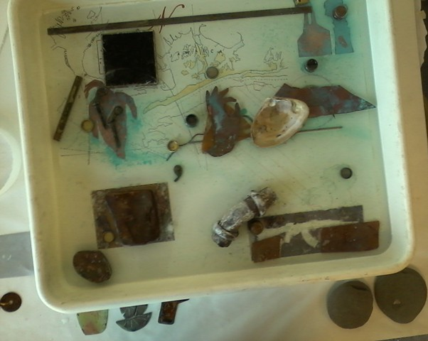 Precipitating Images with iron & copper in trays of salt water