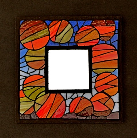 An abstract design on a mirror frame