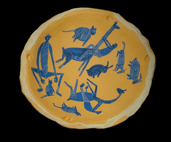 Yellow bowl with figures