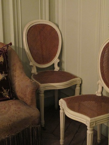 Two cane chairs with silkscreen patterns from 'Neighbors' lightbox transferred to the seat and backing