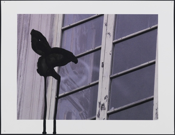 Untitled (window exterior with black shape)