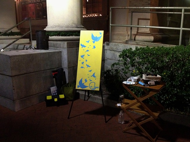 "Painting ""Birds, Not Bombs"" during December Artwalk"