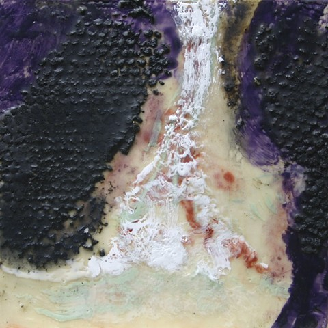 Encaustic waterfall surrounded by rocks of tar and encaustic