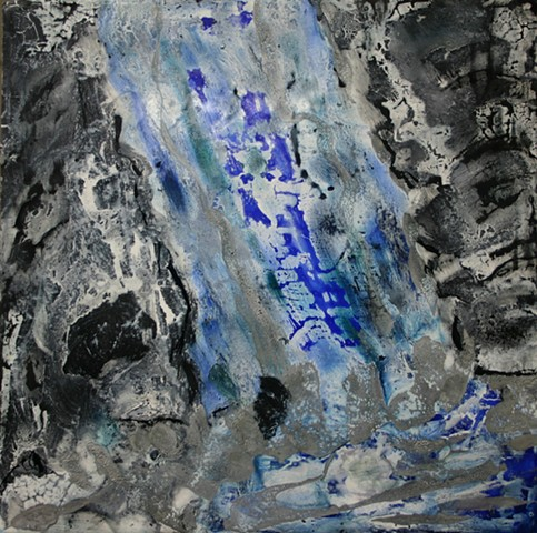 Deep blue waterfall in encaustic sweeps through dark black rocks