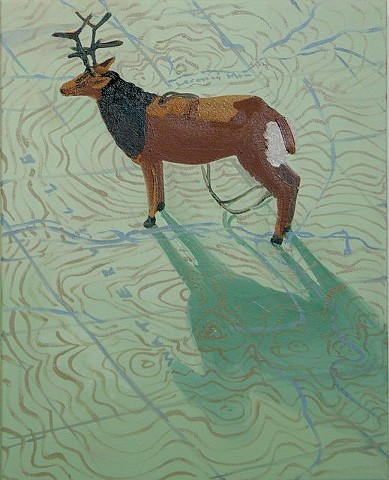 Oil painting of deer ornament on a Vermont topographical map