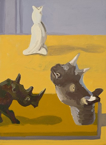painting, two toy rhinos and a pie bird