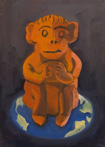 orange monkey sitting on image of earth