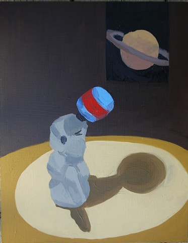 painting of a seal finger puppet balancing a ball in front of a picture of saturn