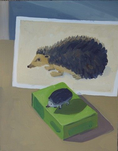 painting of a toy hedgehog in front of a hedgehog postcard