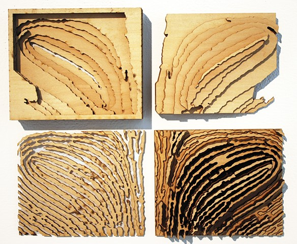 Wooden sculpture based on fingerprint by Janet Williams