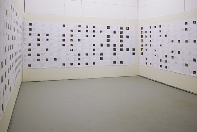 Installation of every page of the book pinned on walls