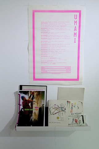 SFR Library and Archive. Installation at Gallery Tigomigo, Terrassa.  UMAMI poster, The Mothernists Conference 2.0, by Lise Haller Beggesen and Driedre Donoghue.  Publications by Irene Pérez.