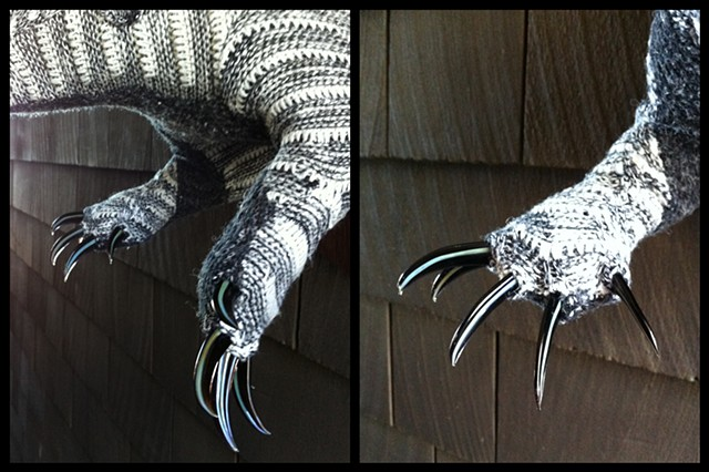 photograph of Sweaty Badger Faux Taxidermy (Cosby Sweater) Handblown glass claws