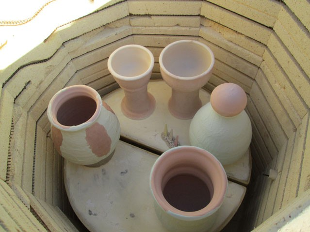 Glazed pottery in the gas kiln before firing.