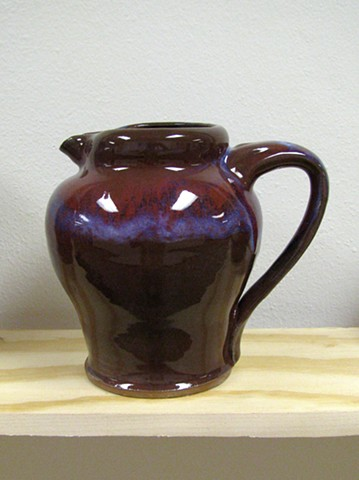 copper red pottery exhibition pitcher