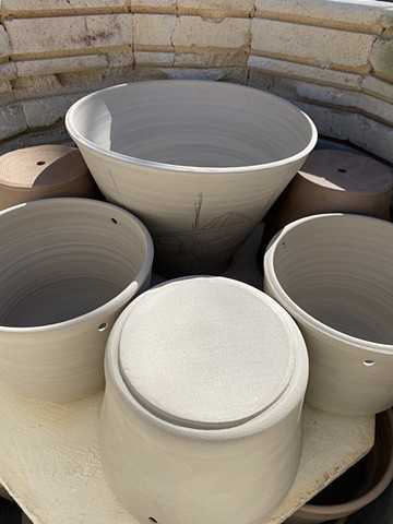 Bisque-firing plant pots in the kiln