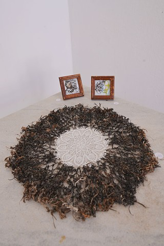 (on a table) Chinatown II, 2015: crocheted seaweed on (ready made) handkerchief with Portrait I and II, 2016: both made of crocheted seaweed and nautical strings