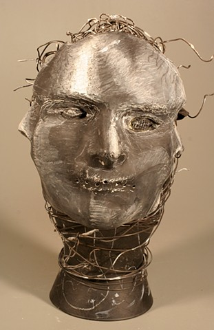 Mask made of Paper Towel, Wood Glue, Wire, Chalkboard paint, Wire and Glass