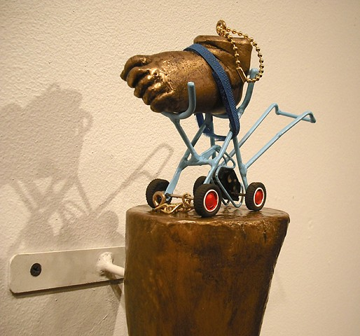 Contemporary sculpture, baby sculpture, Fatherhood and art, toy car sculpture, lucky rabbit foot