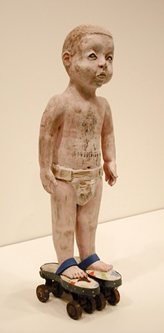 Figurative sculpture, ceramics, one year old, tattoo, rollerskates