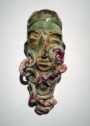 Ceramic mask, chains, glaze, cone 6 stoneware