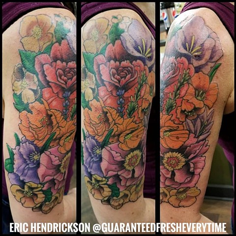 Flower Half Sleeve Tattoo