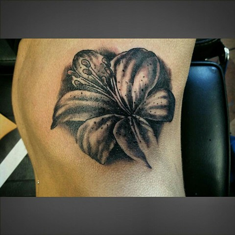 Black and Gray Lily Tattoo on Ribs